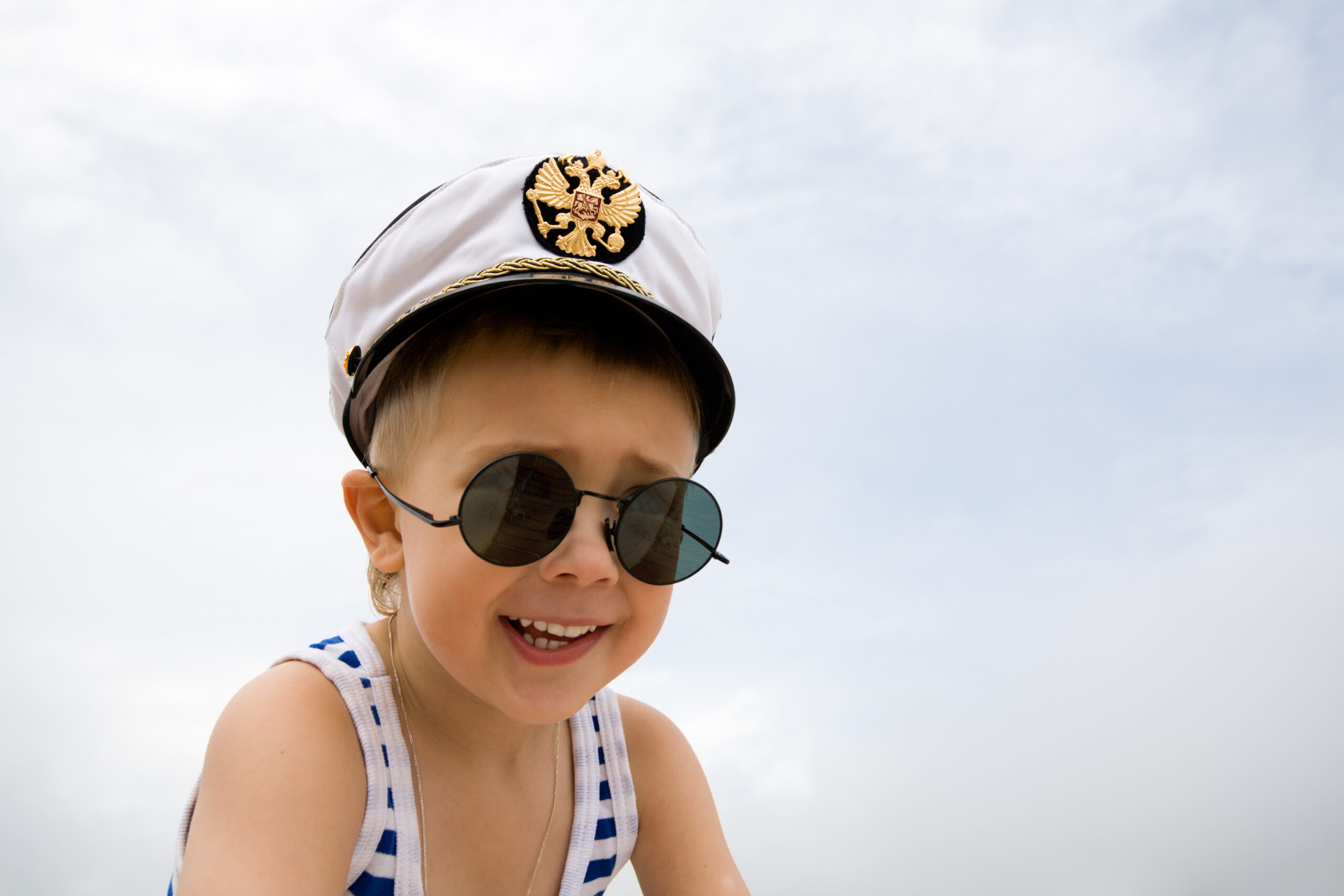 Ship's boy.On a service cap the arms of Russia